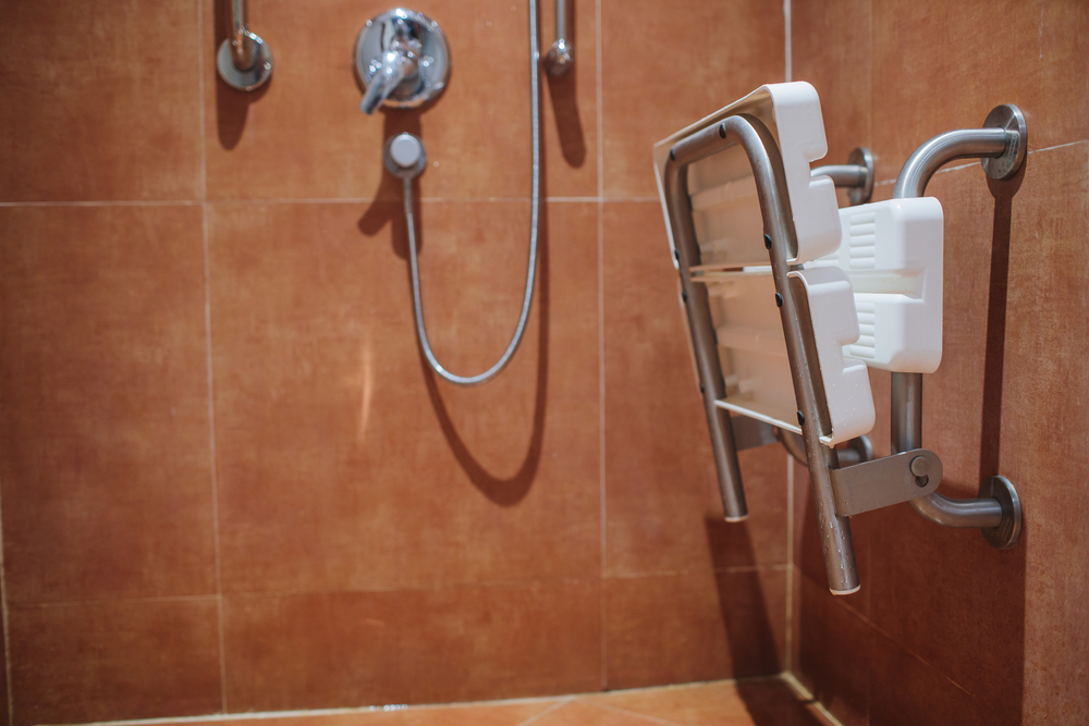 Shower seat with safety bars for accessibility
